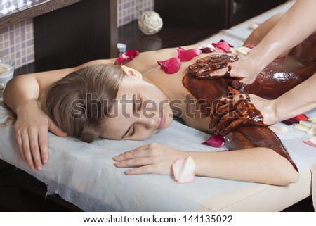 Woman enjoying a massage in a spa setting