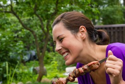 woman enjoying barbecue outdoors