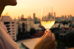 Woman enjoying glass of wine in the city