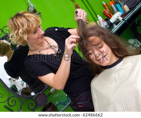 woman enjoying hair and scalp massage in salon