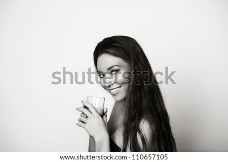 woman enjoying herself drinking from a glass