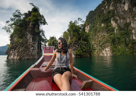 woman enjoying on long tail boat in Khao Sok National Park, Suratthani Thailand. #541301788