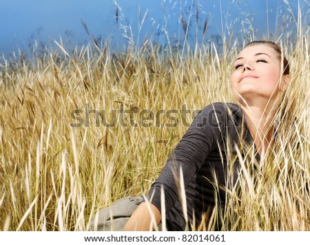 Woman enjoying on the wheat field, nature at autumn, natural landscape background, female outdoor