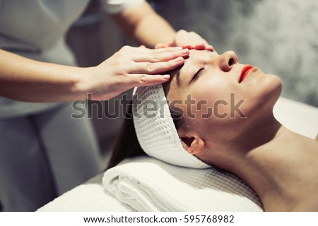 Woman enjoying skin and face treatment and massage
