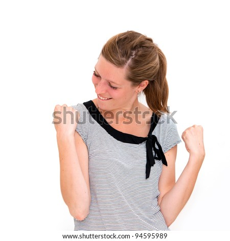 Woman enjoying success with clenched fists