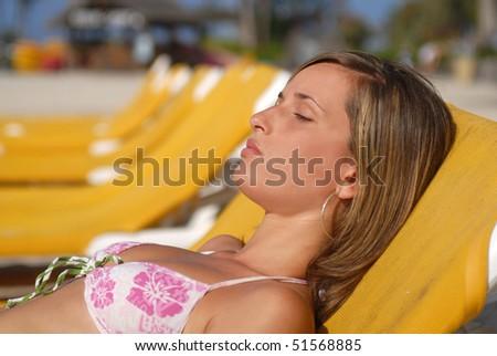 woman enjoying the beach on nice day