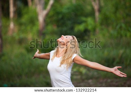 woman enjoying the summer in the forest