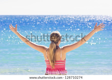 Woman Enjoying the Sunshine at the beach