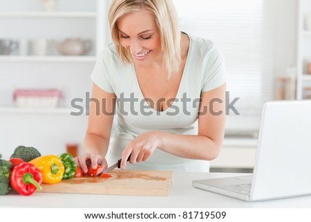 Woman enjoying to cook in the kitchen