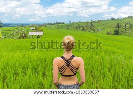 Woman enjoying vacation at beautiful green rice fields on Bali. Concept of vacations, freedom, happiness, enjoyment and well being. #1339359857