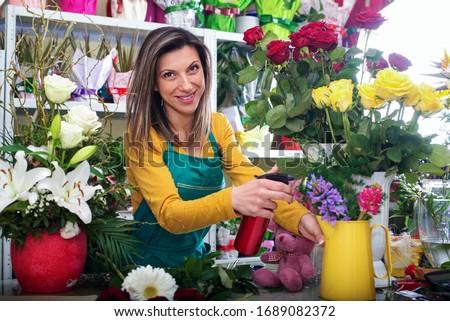 Woman entrepreneur/shop owner/ florist of a small flower shop business Photo stock ©