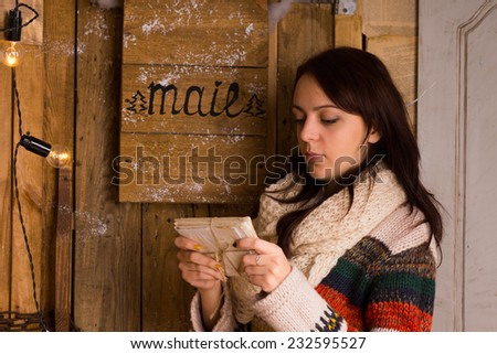 woman examining a bundle of...