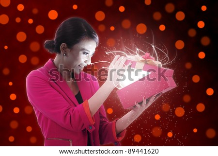 Woman excited opening a present
