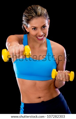 Woman exercising at the gym with free weights