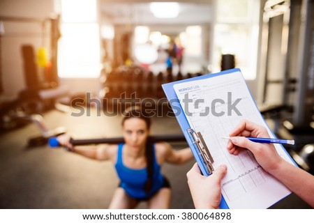 woman exercising in gym ...