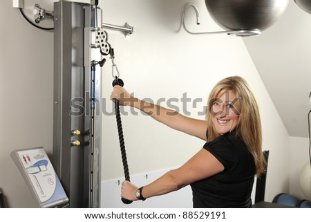 Woman exercising on a machine