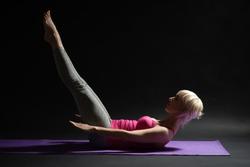Woman exercising pilates. Hundred exercise.