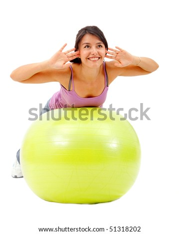 Woman exercising with a pilates ball isolated over a white background