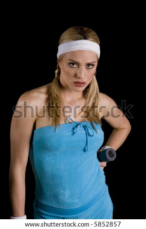Woman exercising with weights against a black background