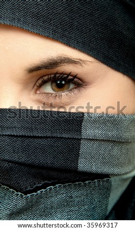 woman eye detail, dressed with a veil