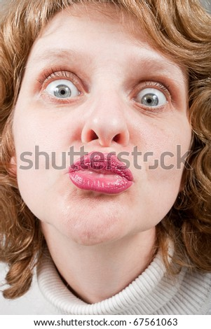 Woman face and lips with pink lipstick