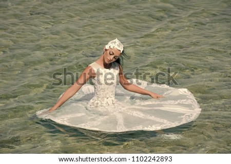 Woman face beauty. Fashion and beauty. Bride on sunny summer day on seascape. Girl sitting in sea water. Honeymoon travel concept. Woman in white wedding dress. #1102242893