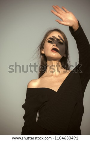 Woman face beauty. Fashion look of stylish woman in black, makeup. Hairdresser and skincare, summer fashion. Beauty and fashion, cosmetics. Elegant woman with long hair. girl with red lips on blue sky #1104630491