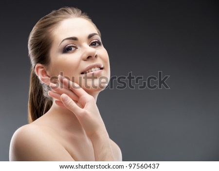 Woman face close up portrait. Beauty body skin care style photo. Isolated on gray