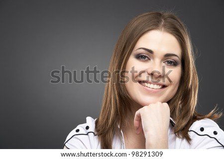 Woman face close up portrait isolated on gray.