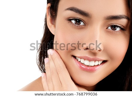 Woman face closeup portrait beautiful beauty model girl with beautiful smile teeth and hand. Studio shot. #768799036