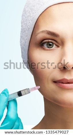 Woman face cosmetology treatment. Biorevitalization skin therapy. Doctor insert filler. Girl clinic facial mesotherapy. Injecting in medical salon. #1335479027
