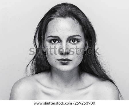 Woman  face freckled young beautiful healthy skin and long hair portrait black and white