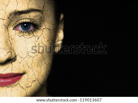 Woman face with cracked earth pattern