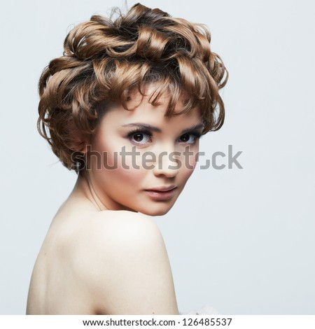 Woman face with curly  hair on white background isolated close up portrait.
