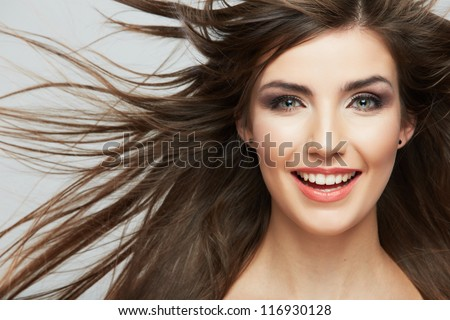 Woman face with hair motion on white background isolated close up portrait. - stock photo