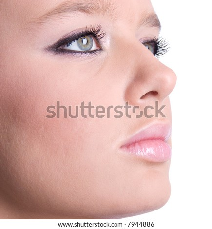 Woman face with makeup closeup. Isolated on white.