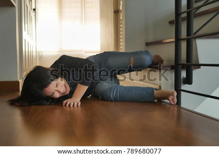 woman falling down from staircase, dangerous situation, bad day, injury, insurance concept. woman suffering or woman hurting from accident, poor woman in danger, girl injury breaking her leg bone