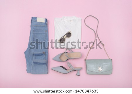 Woman fashion accessories and accessories collage   Set on pink background ,blue jeans , white shirts,sunglasses,high hell shoes,