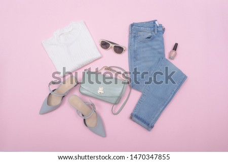 Woman fashion accessories and accessories collage   Set on pink background ,blue jeans , white shirts,sunglasses,high hell shoes, Bracelet,makeup