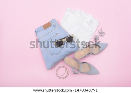 Woman fashion accessories and accessories collage   Set on pink background ,blue jeans , white shirts,sunglasses,high hell shoes, Bracelet