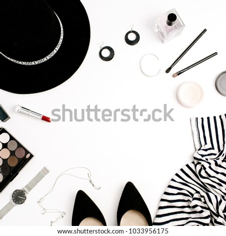 Woman fashion flatlay. Frame of modern clothes, accessories and cosmetics. T-shirt, hat, shoes, palette, lipstick, watches, powder on white background. Flat lay, top view. #1033956175