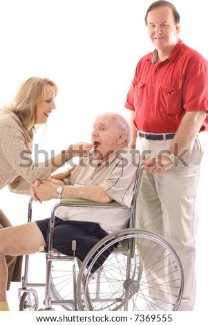 woman feeding elderly man in wheelchair