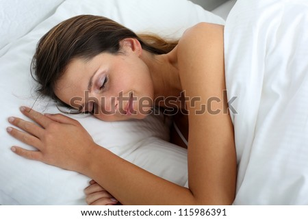 Woman feeling good asleep in bed