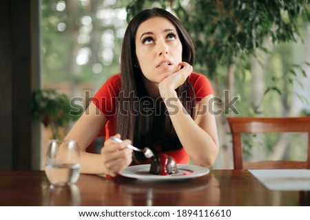 Woman Feeling Guilty for Eating Chocolate Cake. Girl on a diet thinking about taking a cheat day  Stock photo ©