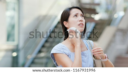 Woman feeling hot at outdoor