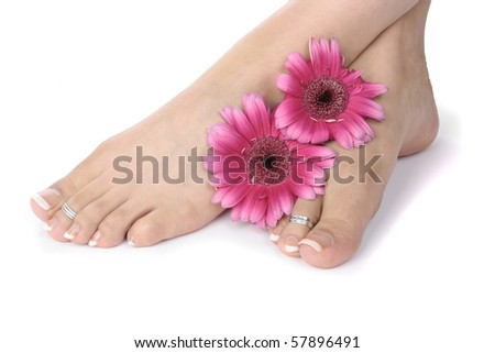 Woman  feet  and flowers  over white