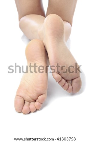 Woman feet and  legs isolated over white background