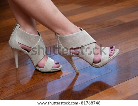 woman feet in high heels summer sandals shoes