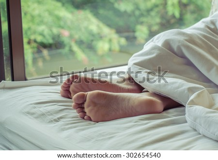 woman feet on the bed