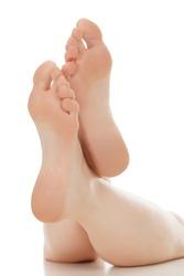 Woman feet over white